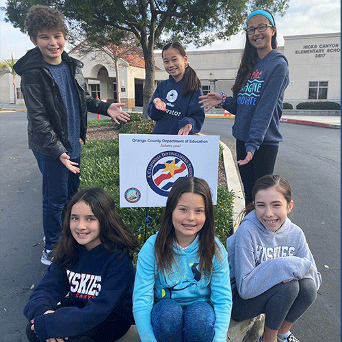Hicks Canyon Students Standing around A California Distinguished School Sign