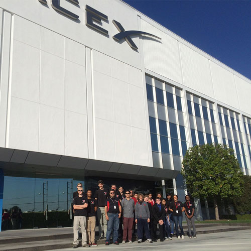 Tustin High school students standing in front of Space X building