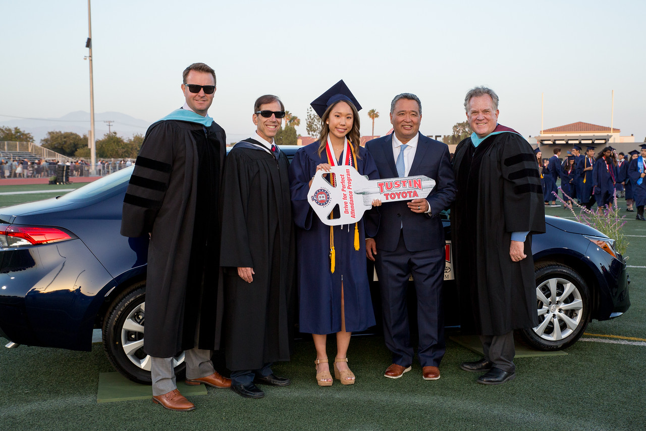 Picture of Beckman High School Principal, Donnie Rafter, Board Member Jonathan Abelove, Sophie Nguyen, Glenn Kashima, and Superintendent Greg Franklin in front of new Toyota Corolla