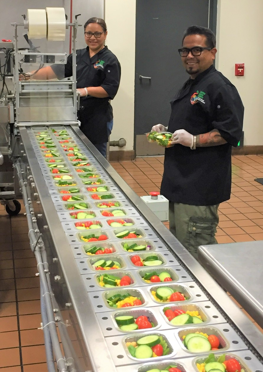 Nutrition staff prepping salads