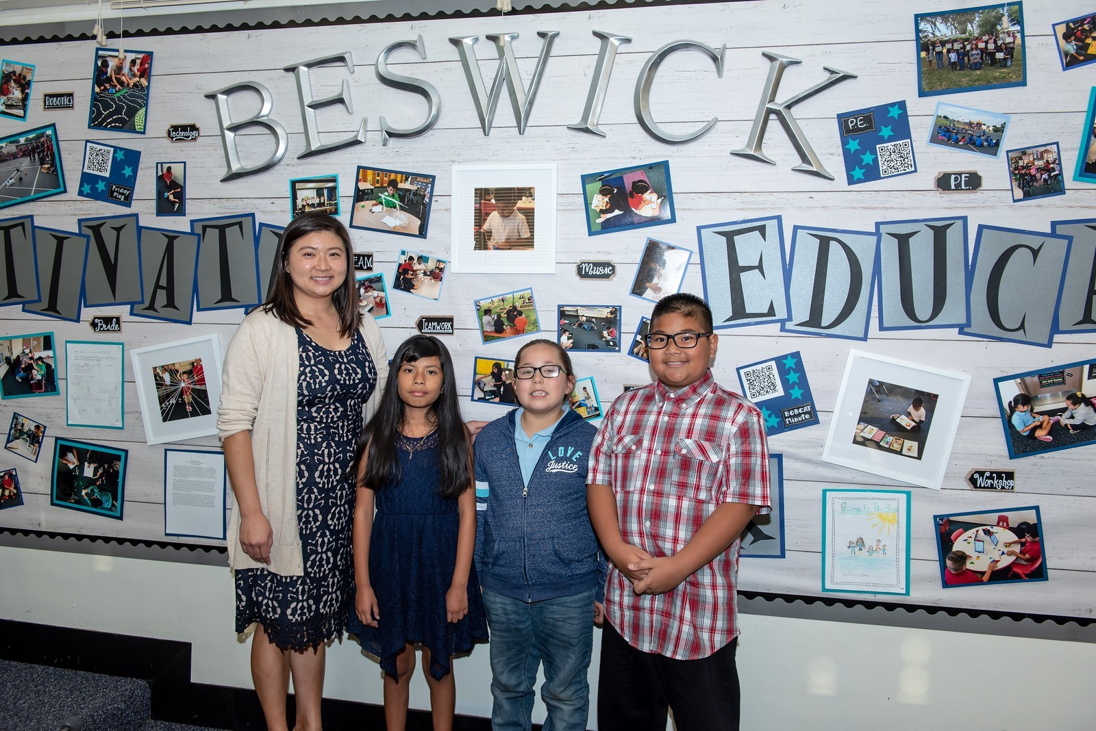 Beswick Salute to Schools Board Room Display Photo of Display, principal and three students