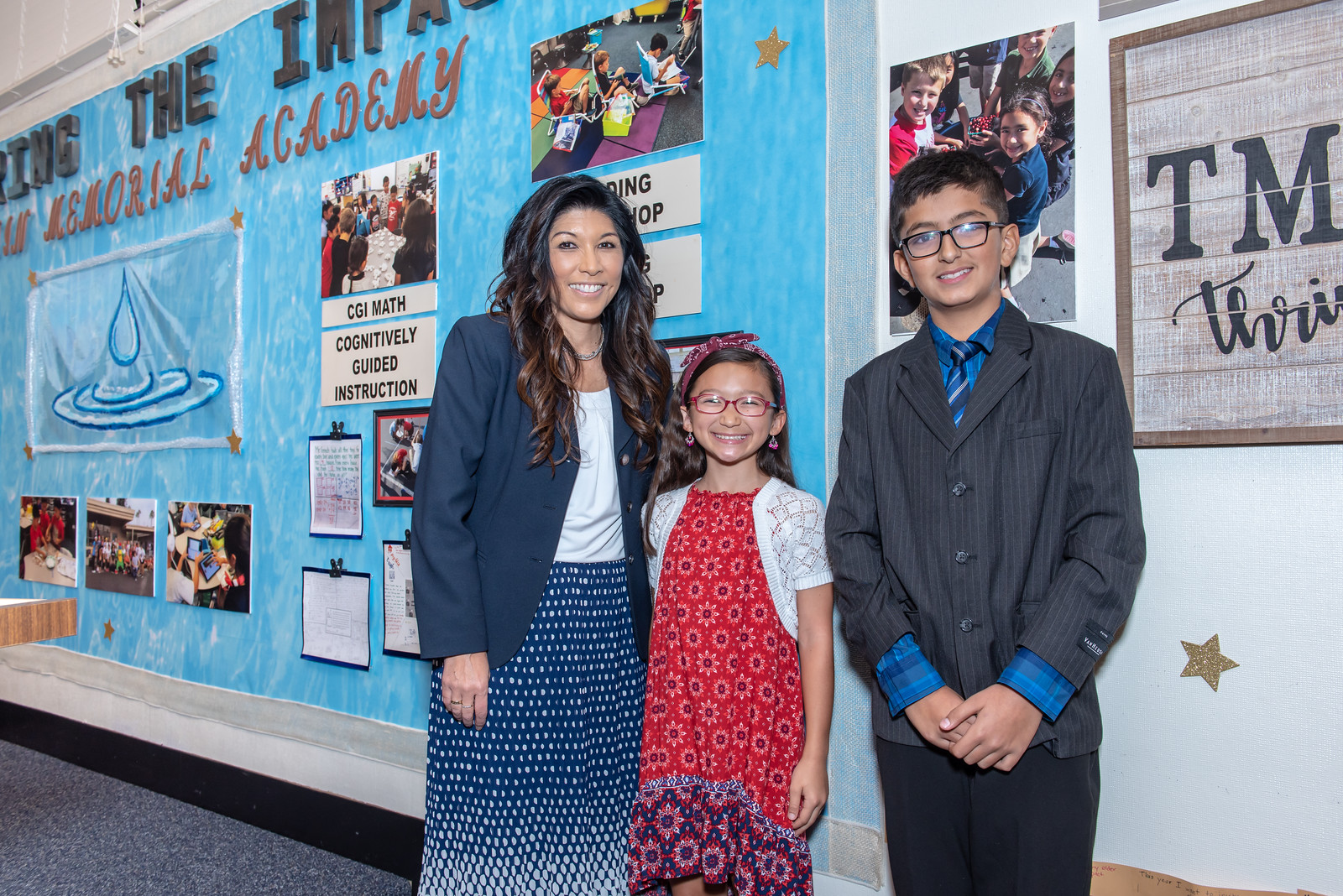 TMA's Board Room Display with the principal and two students