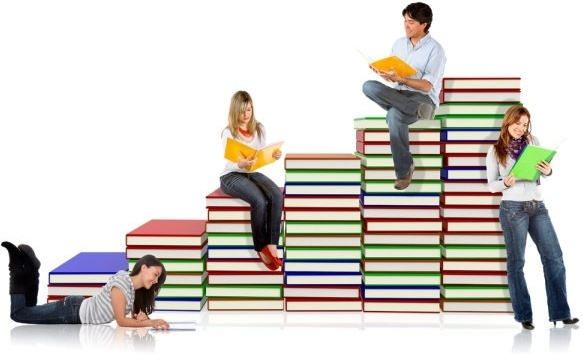 Photo of students by and on piles of books