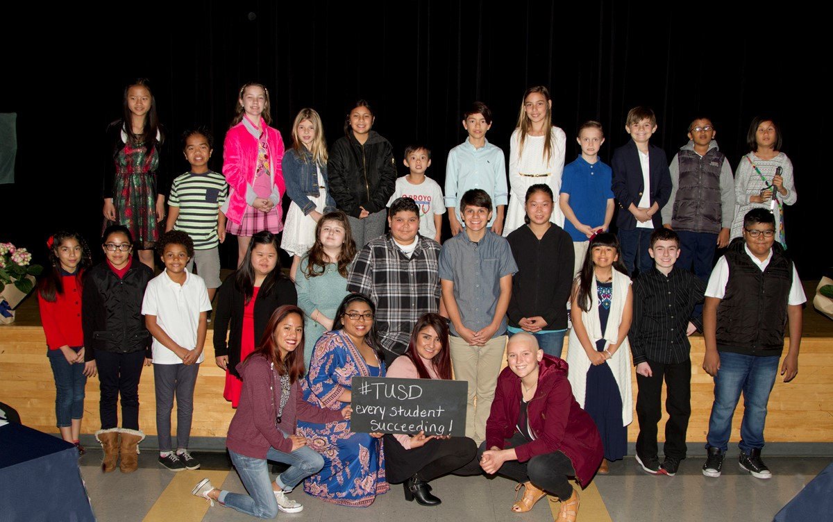Group photo of kids at Every Student Succeeding Awards Breakfast