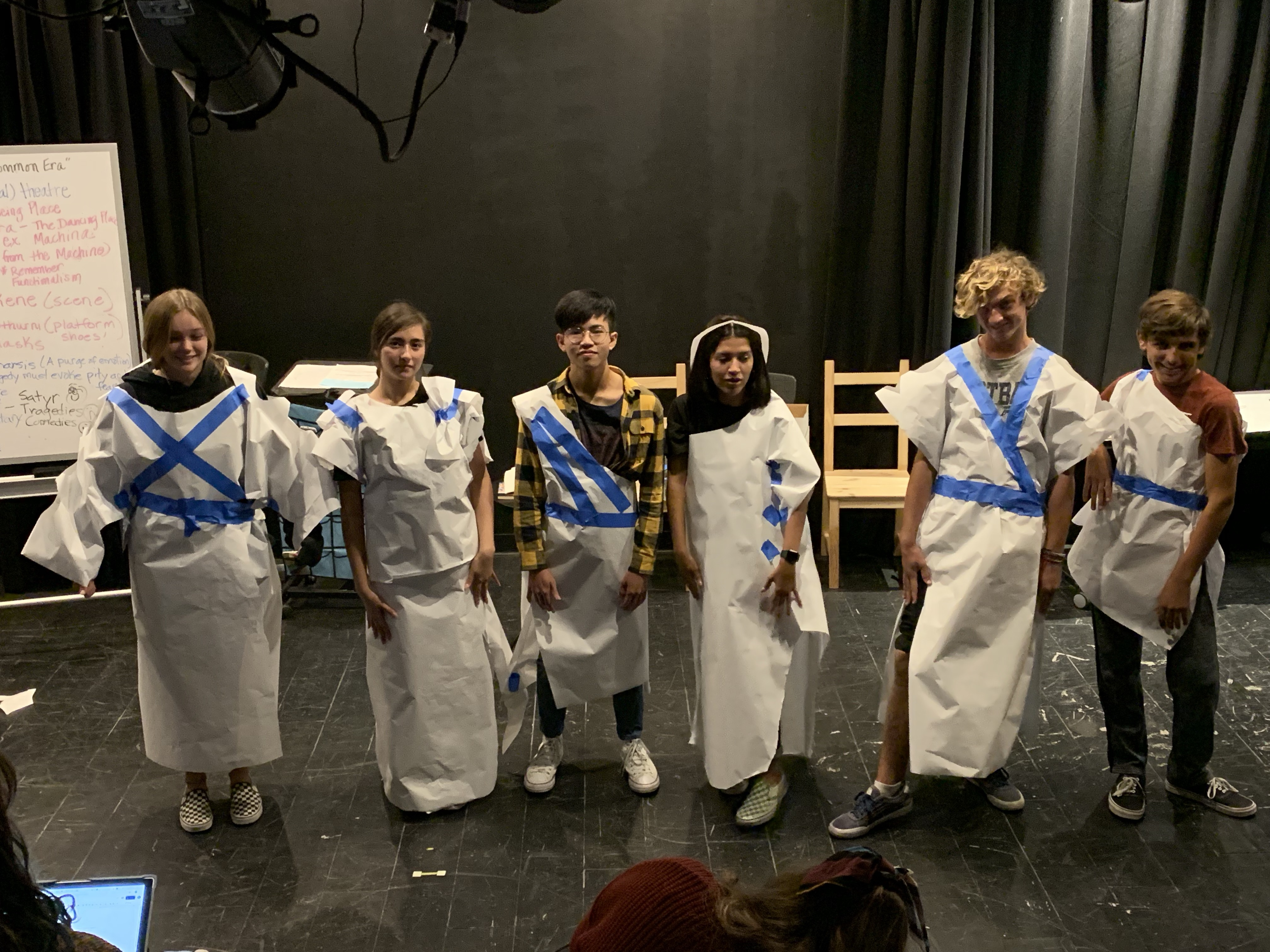 Drama students in togas they designed
