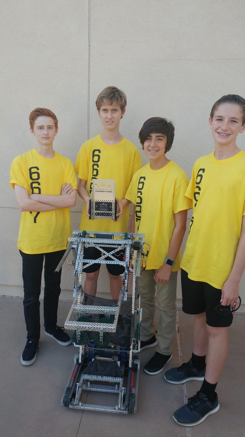 Team 6627A – Jake, Blaise, Miguel and Ryan (left to right) with their winning robot and championship trophy.