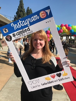 Counselor 2 at #Applied holding an Instagram Frame