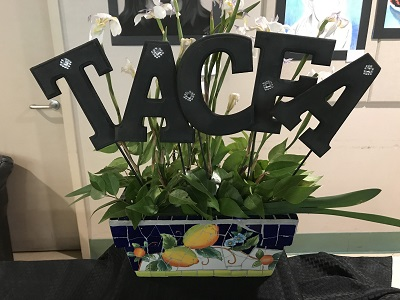 TACFA sign in a potted plant