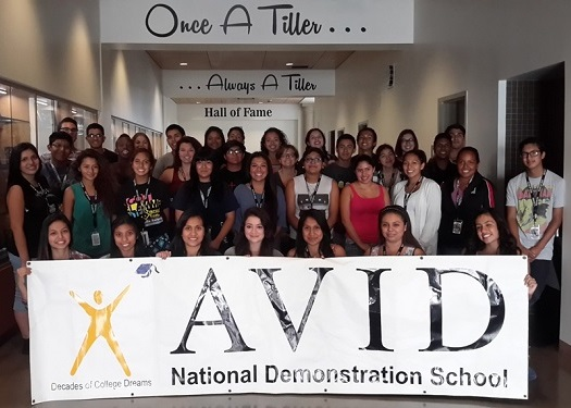 THS AVID holding the National Demonstration school banner